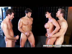 Brunette with big fake boobs Jewels Jade is satisfying three young guys and enjoying rough foursome